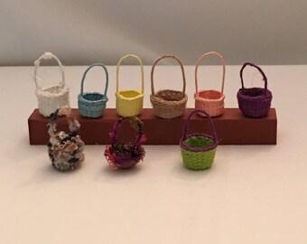 Nine handcrafted miniature baskets.