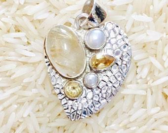 Rudilated Quartz, citrine and pearl pendant. (92.5)