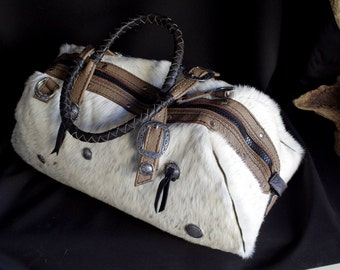 handbag, travel bag, leather and skin Deco inspiration western conchos