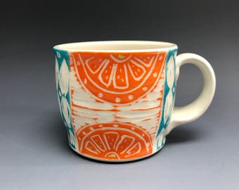 Orange and turquoise mug porcelain mug
