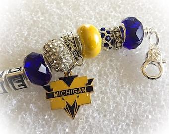 Fabulous University of Michigan inspired jewelry GO Blue bracelets body Bling with dangling logo charm.