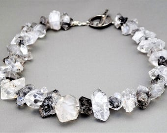 Natural tourmalinated rock crystal quartz necklace.
