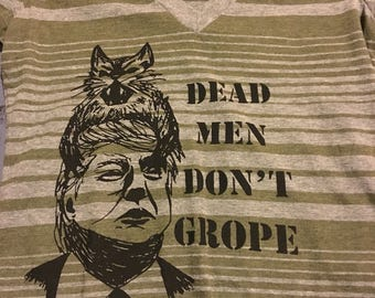 """Striped """"dead men don't grope"""" anti-trump cat attack pussy grabs back shirt. 20% of sales go to brooklyn community bail fund"""