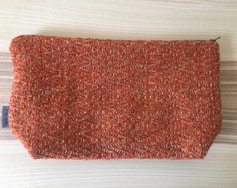 Orange and grey zipped pouch