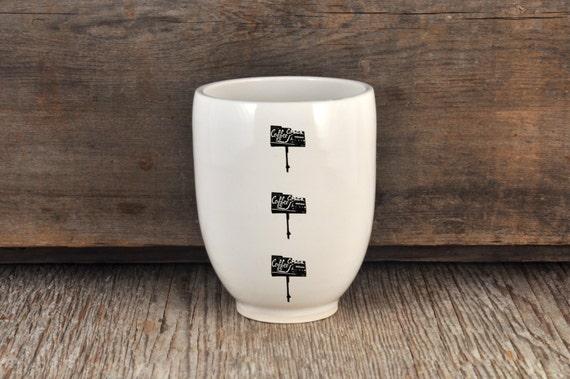 Porcelain tumbler with vintage COFFEE SHOP sign