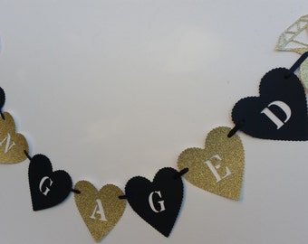 Black and gold glitter engagement banner. Engagement party decoration. Engaged bunting, garland. Engagement hearts
