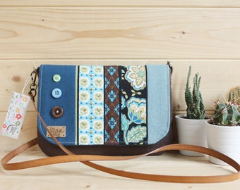 Purse to carry your wrist or shoulder bag with flap decorated with beautiful printed fabric and application of buttons