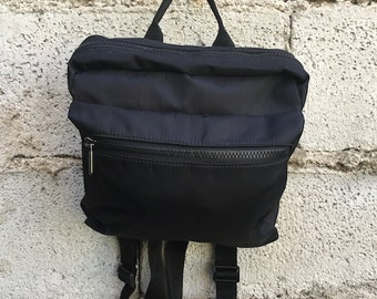 Vintage Backpack/ 90s/ black/ two pockets/ Adjustable straps/ lined/ interior zip/ nylon