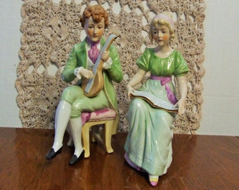 Pair of Victorian Figurines, Porcelain Victorian Couple, Victorian Couple Sitting in High Back Chairs, Victorian Man Playing Music
