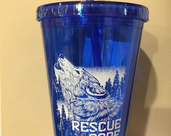 Saint Francis Wolf Sanctuary blue tumbler with lid and straw.
