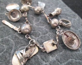 1940's Vintage Solid STERLING SILVER Charm Bracelet> Made in Mexico>> signed> excellent condition> Authentic Mexican Charms> So Pretty!!