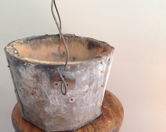 Rustic riveted galvanized and stone bucket