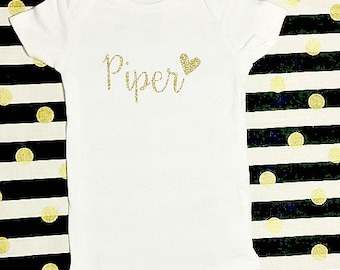 Personalized custom name baby girl onesie bodysuit with heart in white and gold glitter hospital outfit