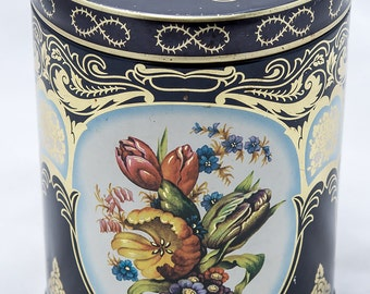 Black, Gold, Floral Design Cylinder Vintage Dahr Tin
