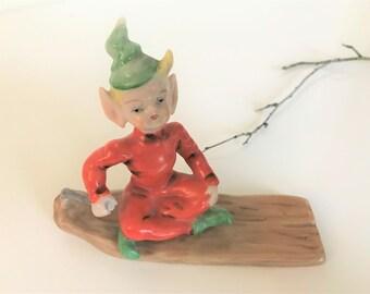 Vintage pixie elf green hat orange Occupied Japan elf sled figurine porcelain kitschy cute nursery decor hand painted collectible miniature