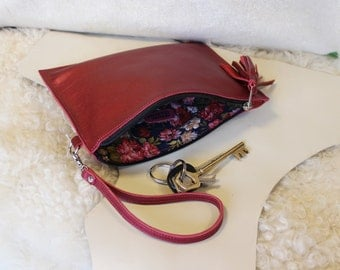 Shiny pink leather clutch bag