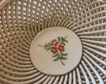 Adorable vintage bowl accented with flower