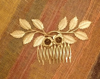 Comb with leaves and flowers of brass