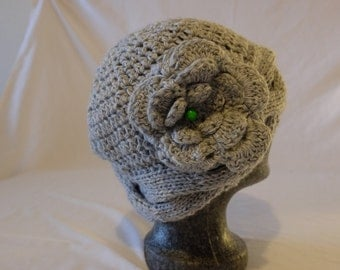 Knitted crochet hat with flower