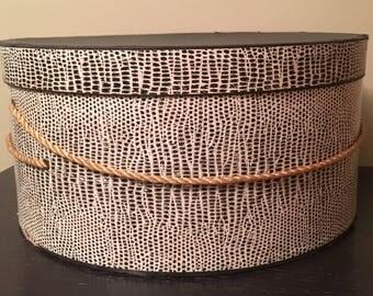 Vintage, round, black and white snakeskin hat box, Julius Garfinckel & Co., Washington, DC, with string handle.