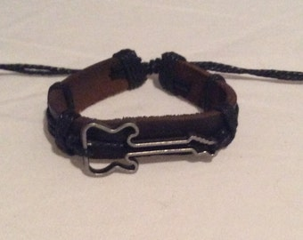 Black and brown bracelet with hollow guitar tied on friendship gift