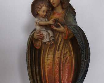 polychrome plaster image of Mary with the infant Jesus