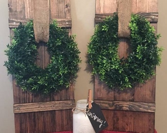 Barn shutters, wreath included.