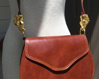 1996 Cognac leather equestrian  crossbody handbag with gold tone horse heads