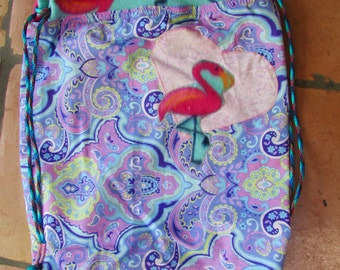 Clearance sale now! Ten dollars off Fun paisley, flamingo backpack with inner pocket