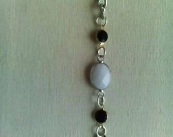 Metal bracelet with white Onyx and Swarovski crystals