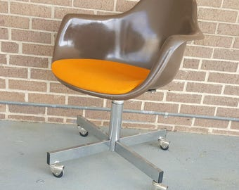 Mid Century Modern Orange and Brown Molded Seat Rolling Office Desk Chair