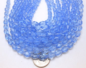 48 Light Blue Oval Glass Beads faceted (H2265)