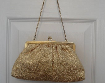 Vintage evening bag Hand Made in Hong Kong, 1970s, Gold glitter lame fabric, Fully lined, Short gold tone metal chain handle, Top kiss clasp