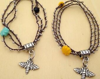 Beaded triple-wrap bee bracelet with dangling bee charm