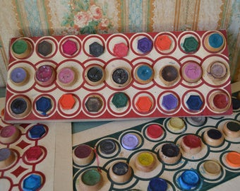 Vintage Watercolor Paints in Wooden Cups Pots on Cardboard