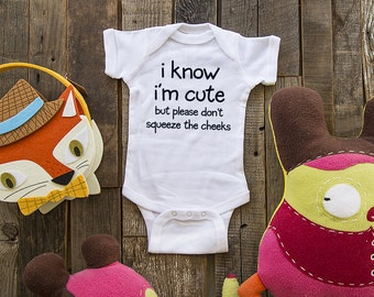i know i'm cute but please don't squeeze the cheeks - funny saying printed on Infant Baby One-piece, Infant Tee, Toddler T-Shirts