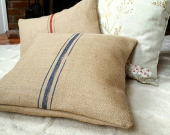 Rustic burlap hessian cushion or bolster - grain sack cloth with red or blue stripes - including cushionpad. Part of the Marmande Collection