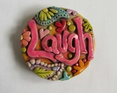 Laugh magnet - antiqued paisley pattern - polymer clay