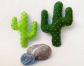 A set of decorative felt cactus pillows