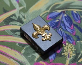 """brass & black matchbox - brass fleur de lis - 1.5 x 2"""""""