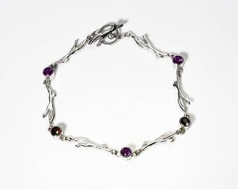 Little Fox Bracelet. Sterling silver with garnet gemstones.