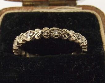 Antique white gold and diamond wedding band