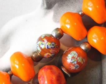 A fabulous, orange, millefiori glass bead necklace.