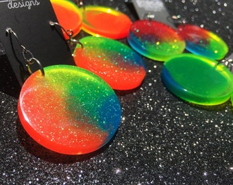 Neon Rainbow Colour Wheel Earrings. Funky fluorescent handmade resin statement disc dangle/drop earrings with nickel-free hooks.