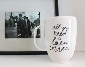 Cup All you need is love and coffee, porcelain, coffee, tea, faithful companions Cup by Cindy Labrecque Design, Visual