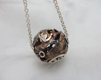 Spherical partially oxidized sterling silver pendant