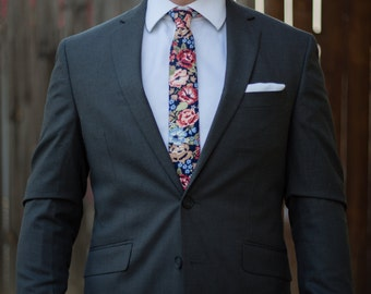 Floral skinny tie with dark blue, red, pink, white, light blue, and tan