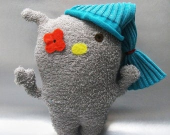cuddly grey monster with hat