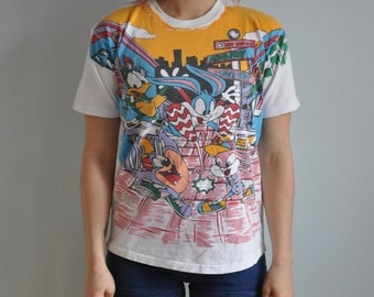 Vintage 1994 Looney Tunes Tiny Tunes All-Over Print Graphic T Shirt 'Bouncin' to do Toons' - Youth XL // Adult XS/S - USA Made