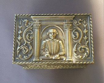 Solid brass box, decorated with 3 Dimensional embossed Shakespeare illustrations and engraving.
